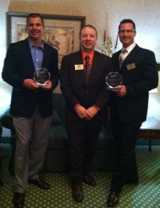 Chris Ellis with Hampton Inn Brooklyn and David Nodge with Brooklyn Adults Activities Center, Cuyahoga County Board of Developmental Disabilities, accept their 2013 Member of the Year Awards from Chamber President, David Hill (Dollar Bank)