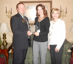 David Hill, Chamber President, presents Stacy Perkins and Lisa Dove with Ridge Park Square (Zeisler Morgan Properties) with their award.