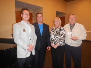 Chris Ellis, Chamber President, and David Nodge, Chamber Vice President, presented Ed Gonzalez and Rose Ortosky with their Large Business Member of the Year award at our November 12th Holiday Social.